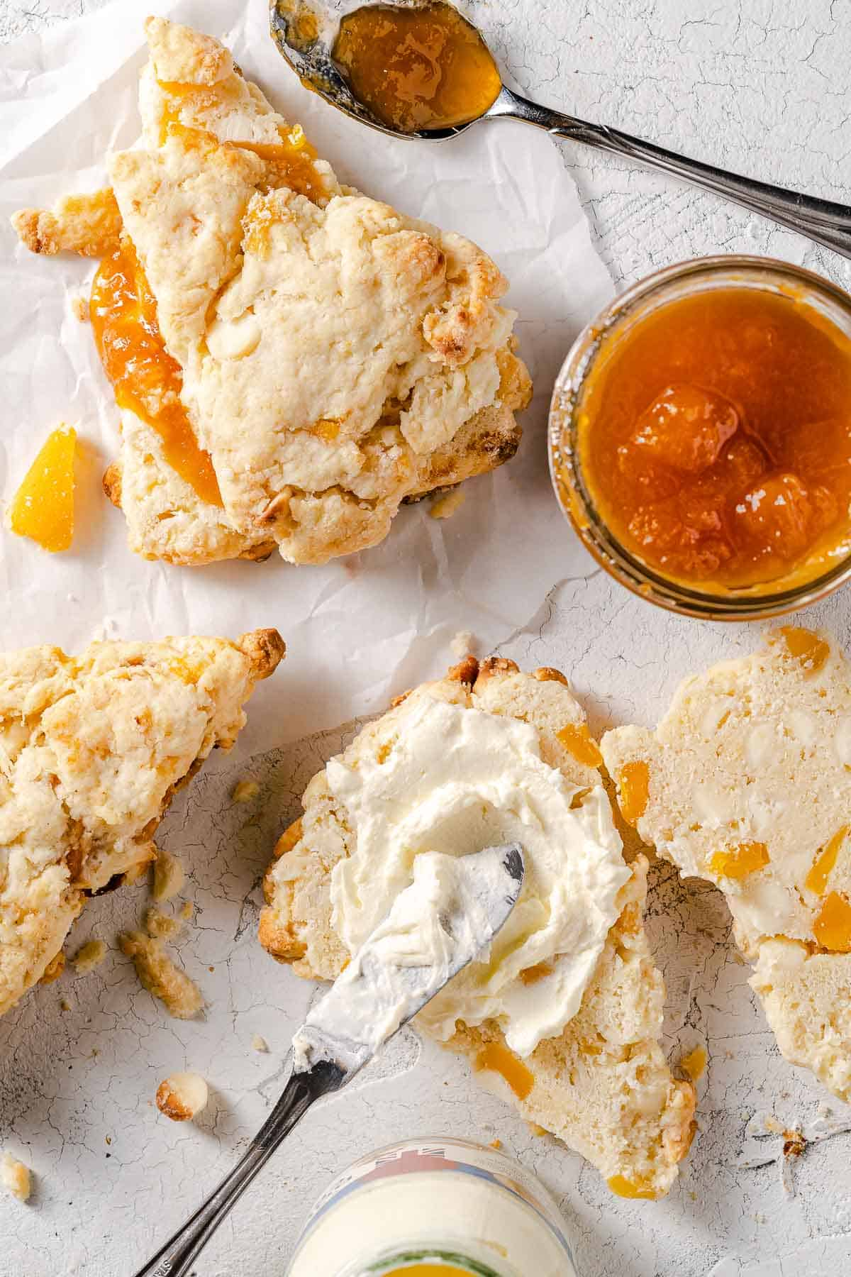 mango white chocolate scones with jam and cream