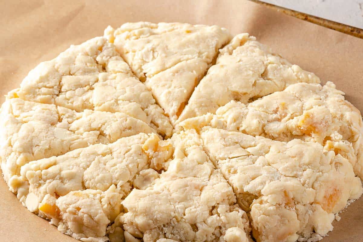 circle of scone dough cut into 8 wedges