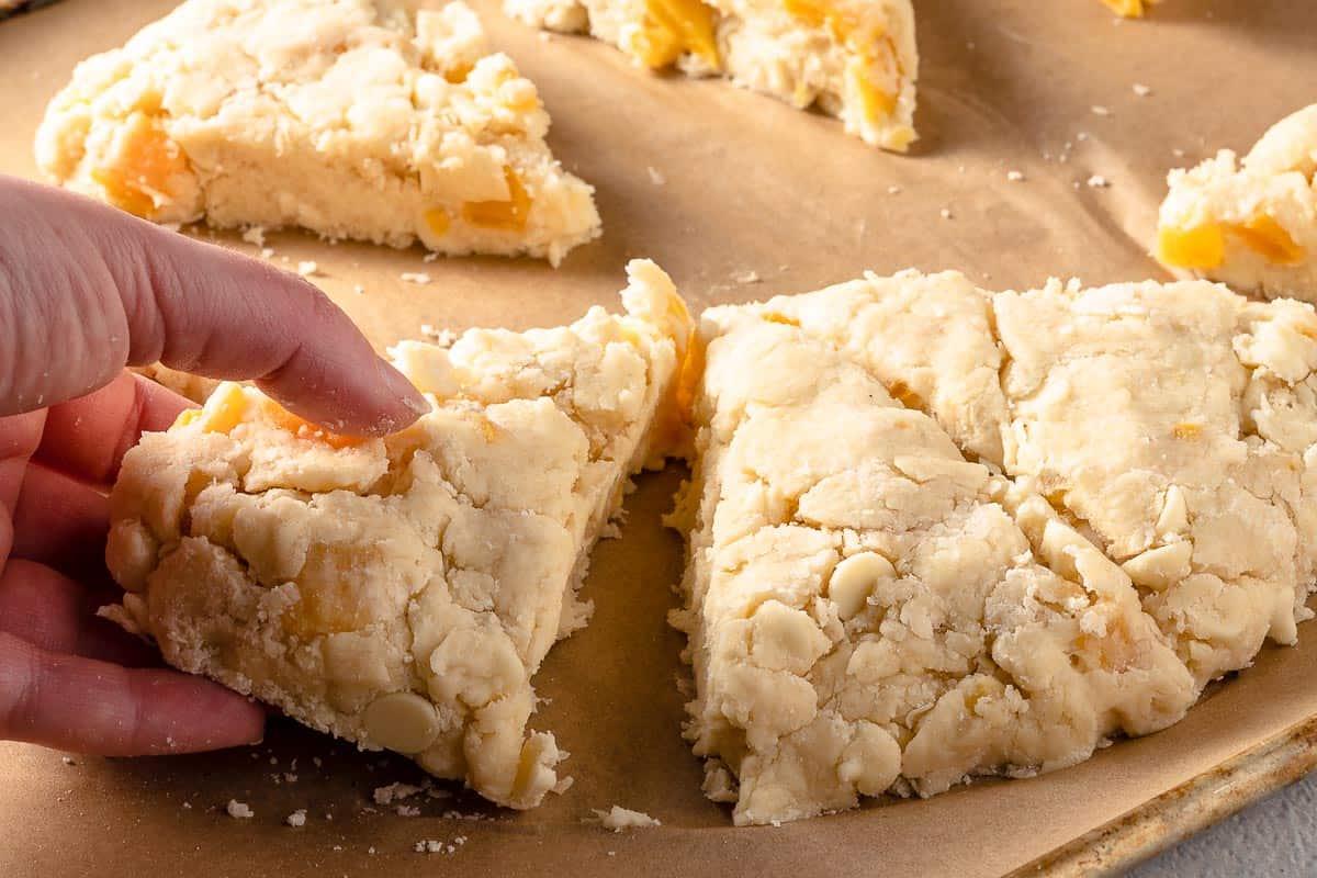separating scones on baking sheet