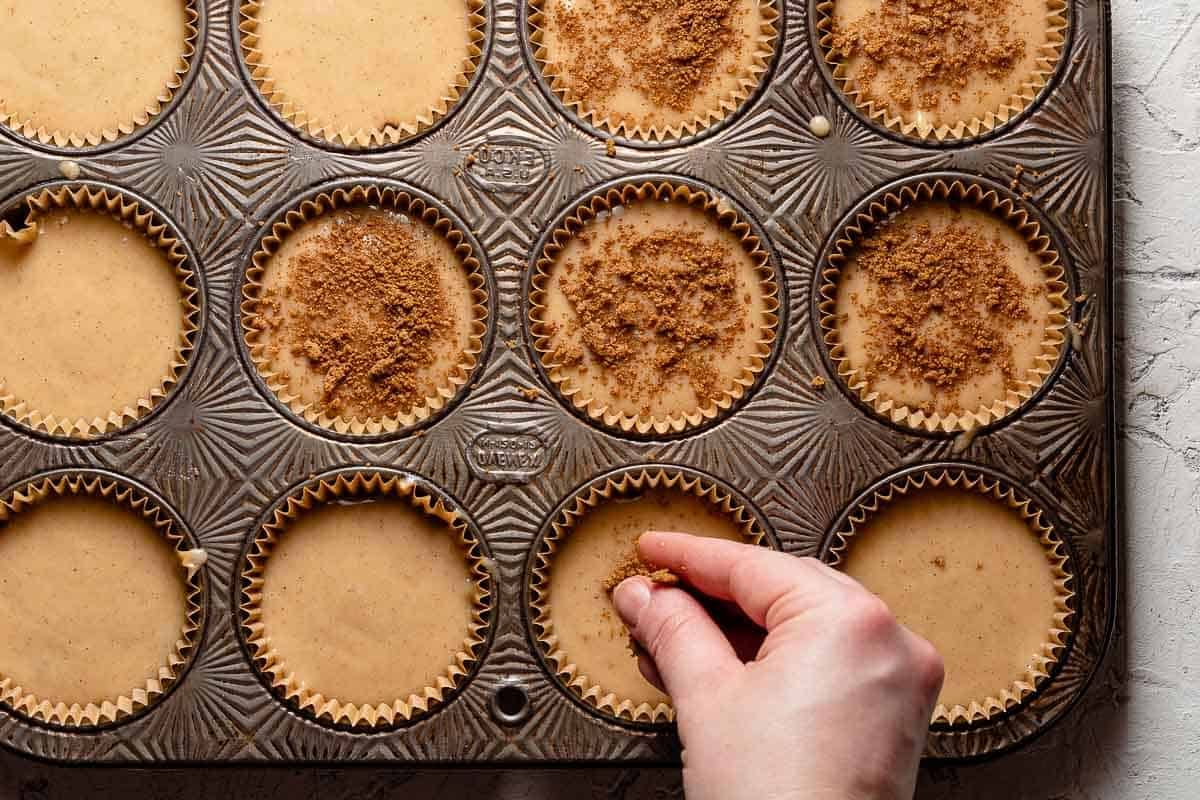 sprinkling cinnamon brown sugar on top of muffin batter