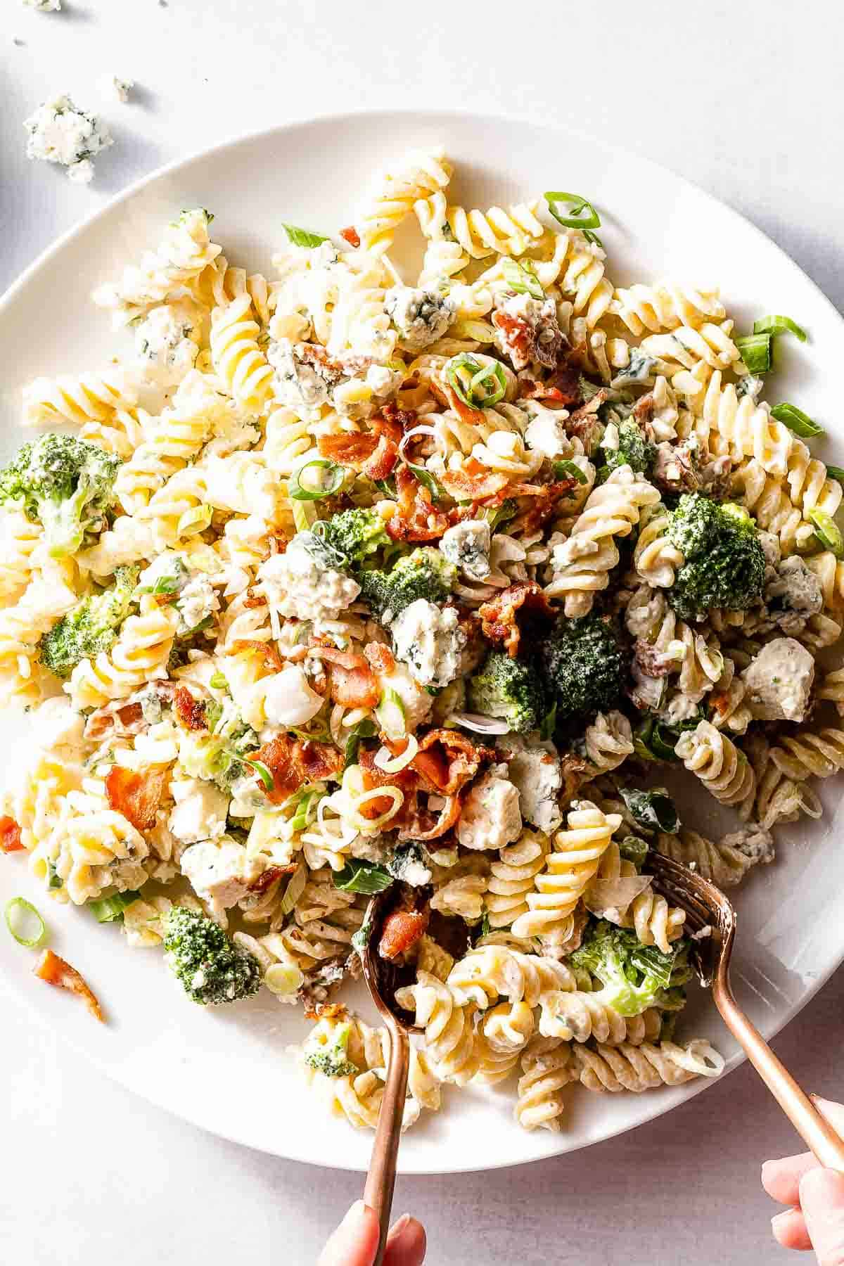 bacon blue cheese pasta salad with serving tongs