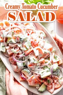 creamy tomato cucumber salad on platter with text overlay