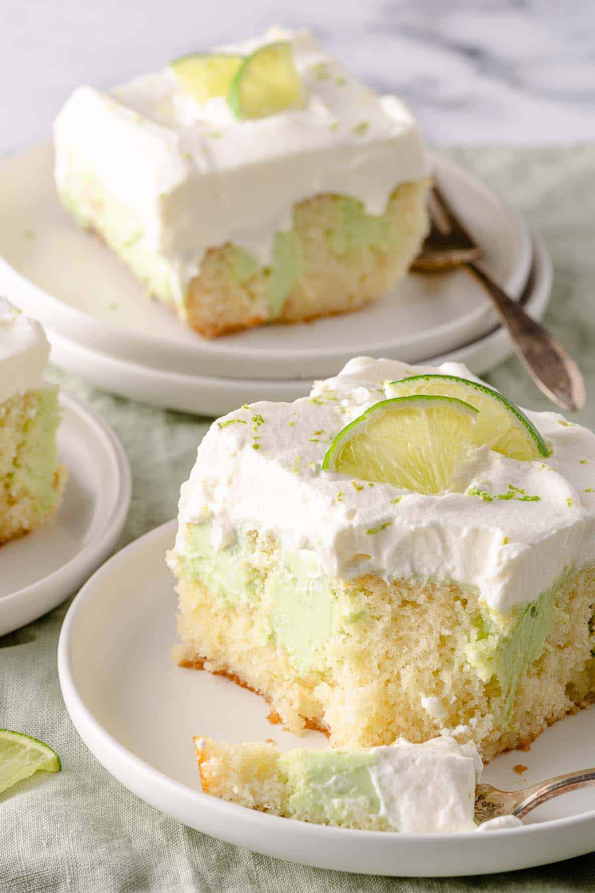 key lime poke cake on two plates