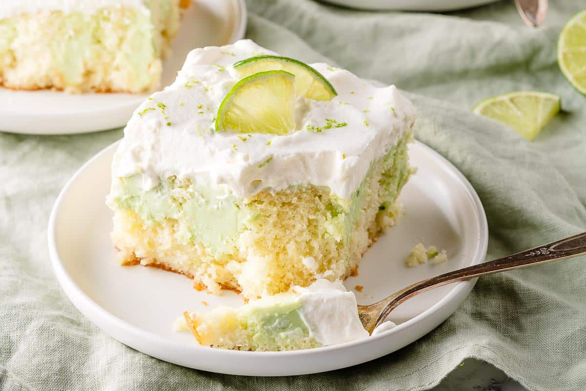 key lime poke cake on plate with fork