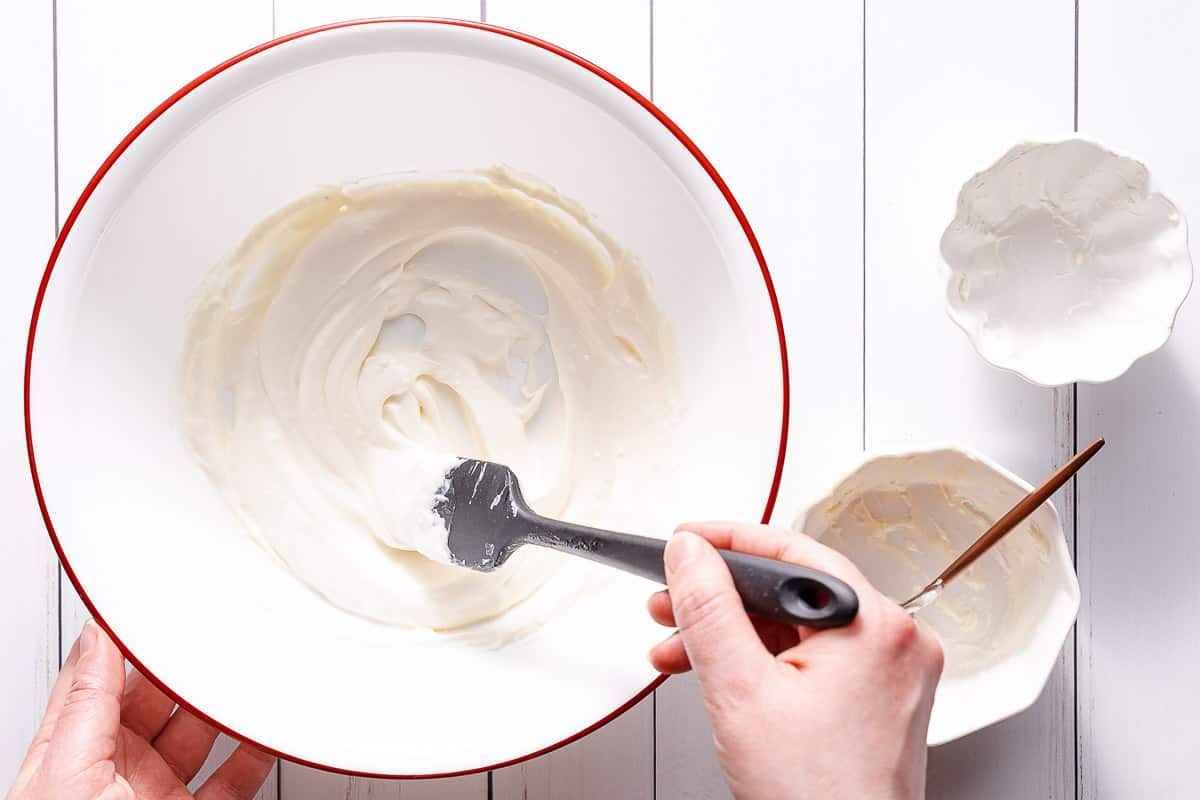 dressing being mixed in large bowl