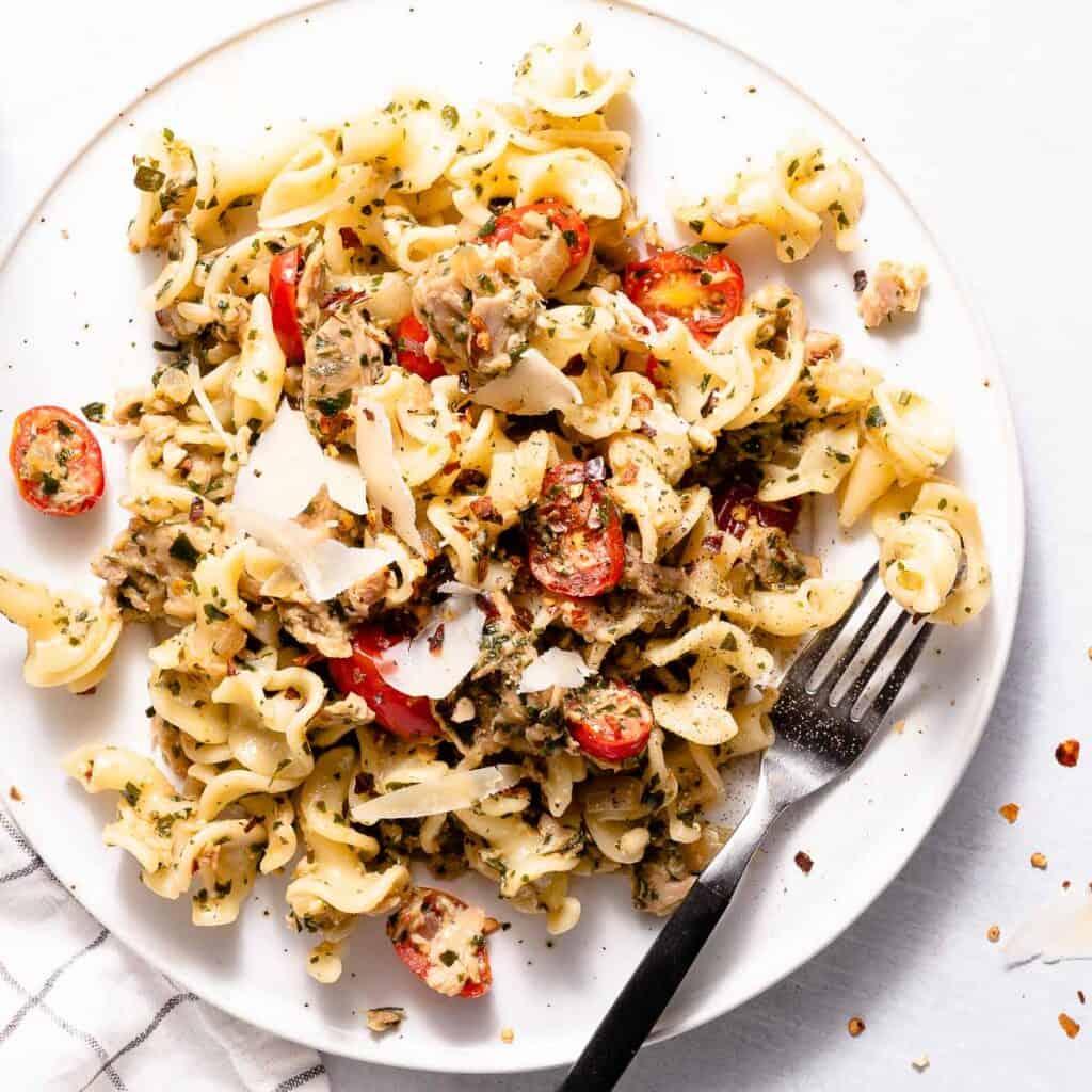 tuna pesto pasta on white plate