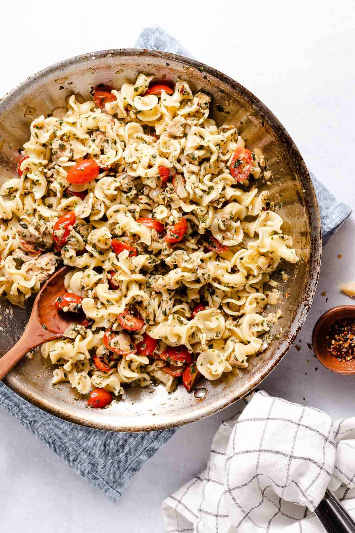 tuna pesto pasta in pan with wooden spoon