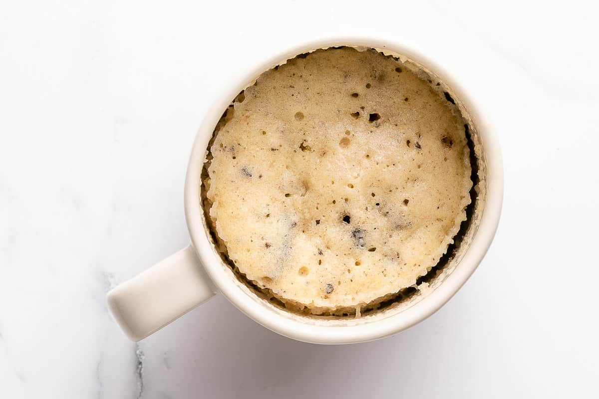 cooked Oreo mug cake in white mug