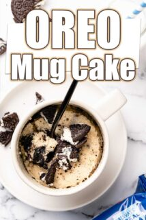 mug cake with Oreos crumbled on top and black spoon with text overlay
