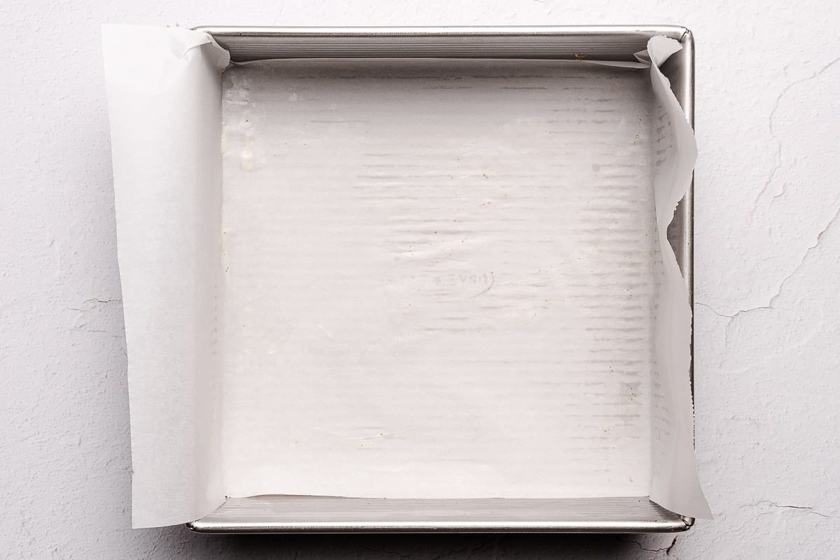 square pan with parchment paper inside