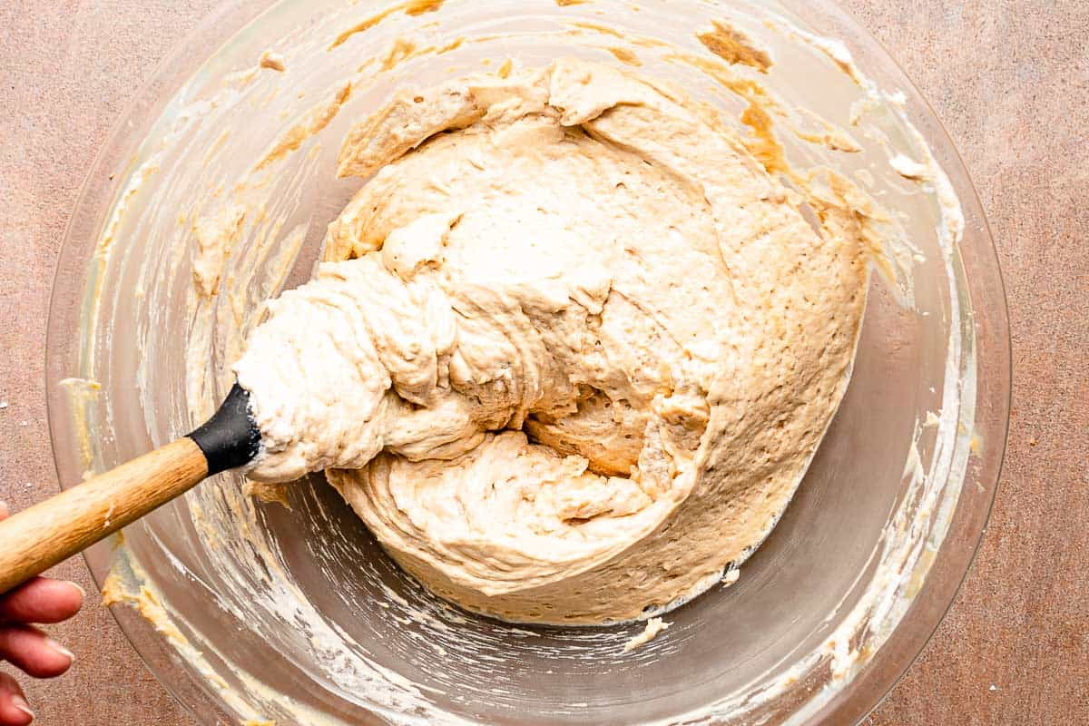 finished peanut butter cream cheese layer in bowl with spatula
