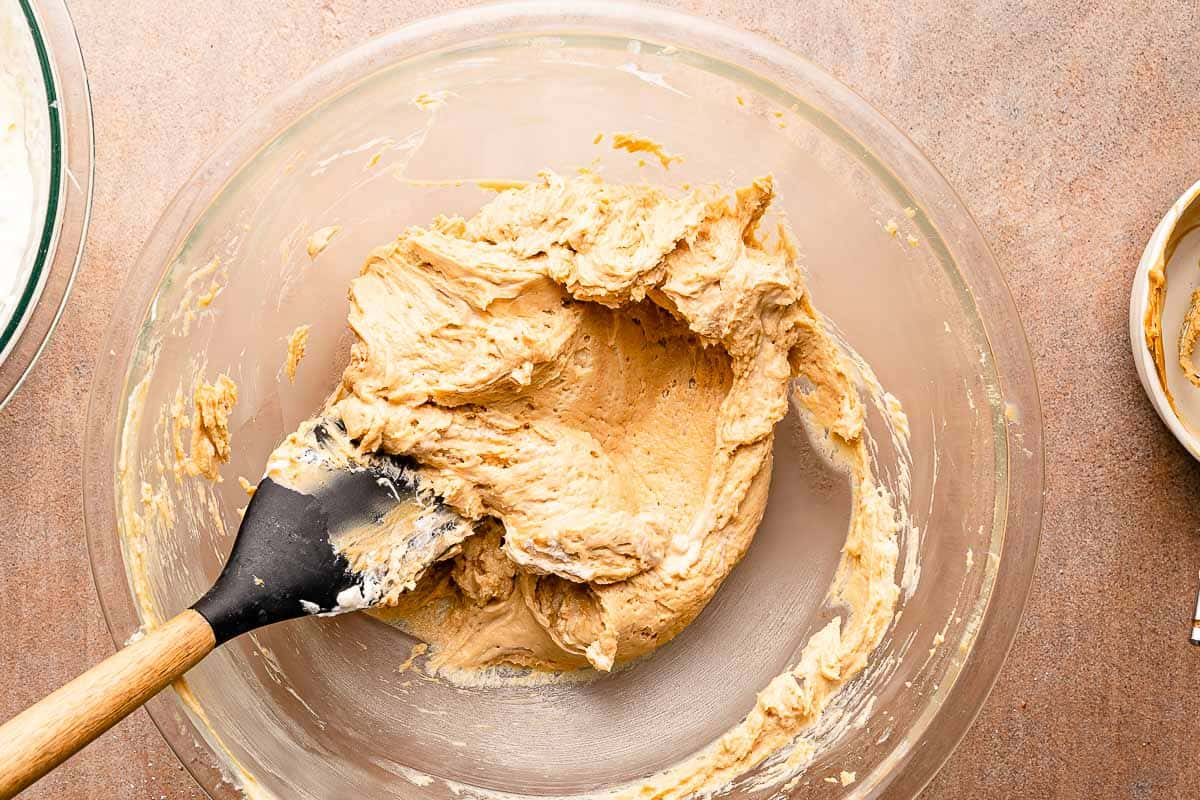 whipped cream mixed into peanut butter in bowl