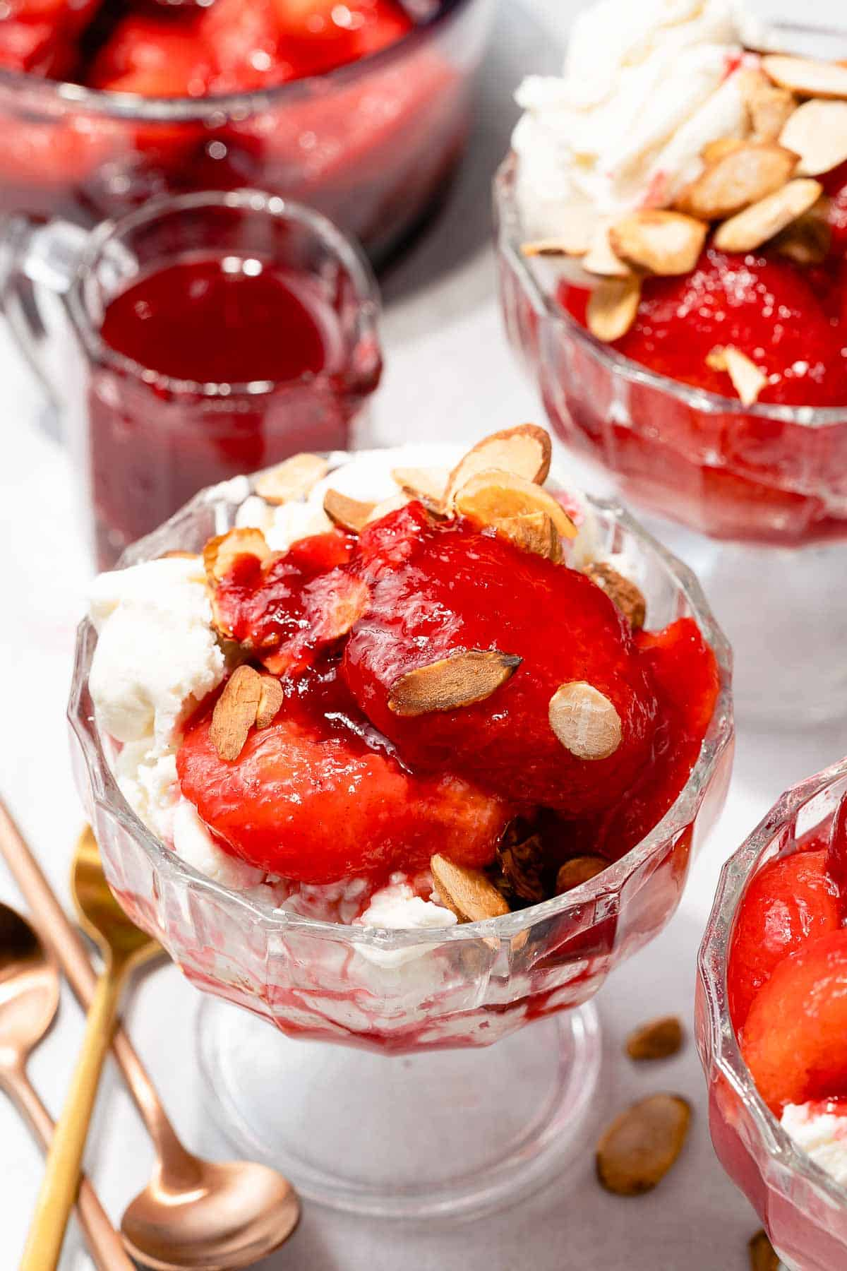 stewed plums on ice cream with sauce on the side