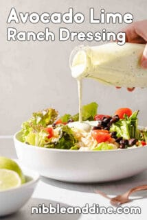 avocado lime ranch dressing being drizzled over salad with text at the top and bottom