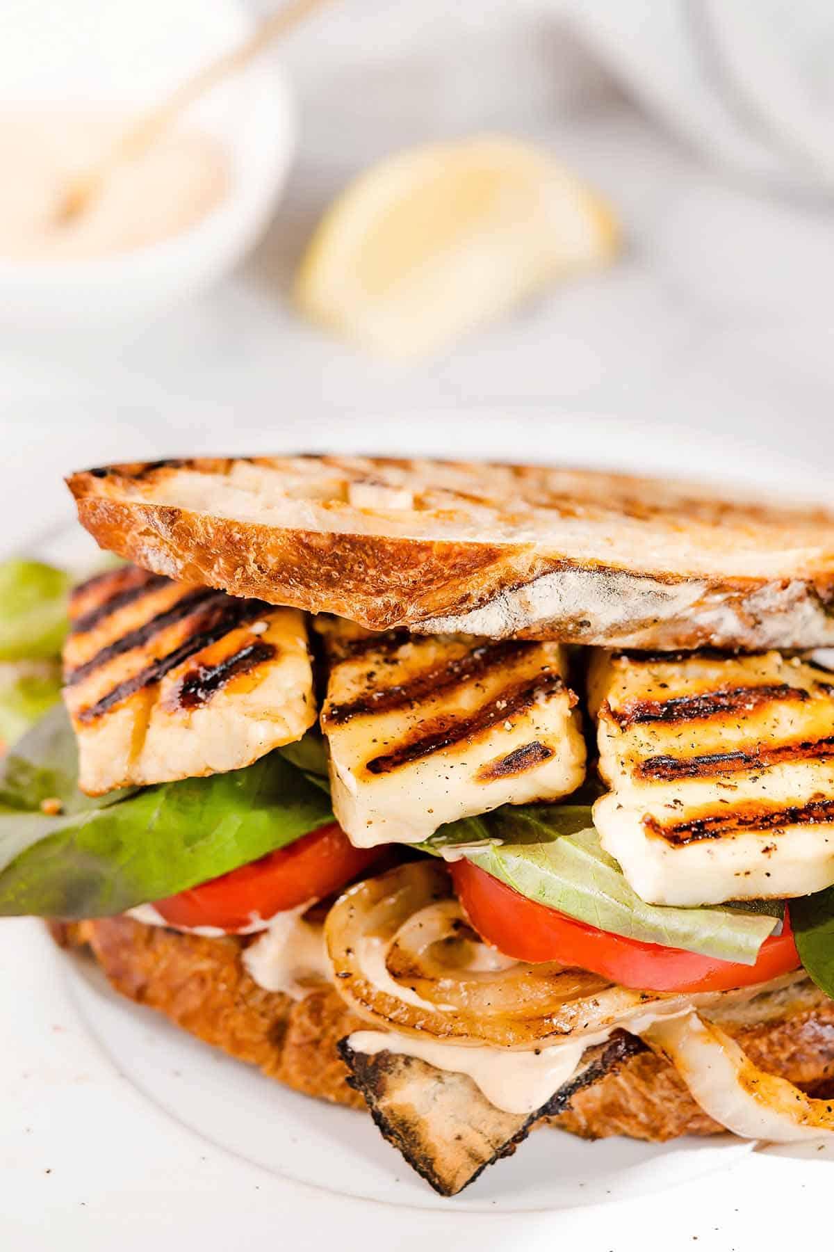 halloumi sandwich on white plate