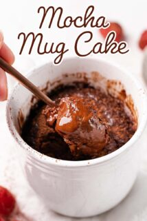 mug cake with spoon taking a scoop out with text at the top