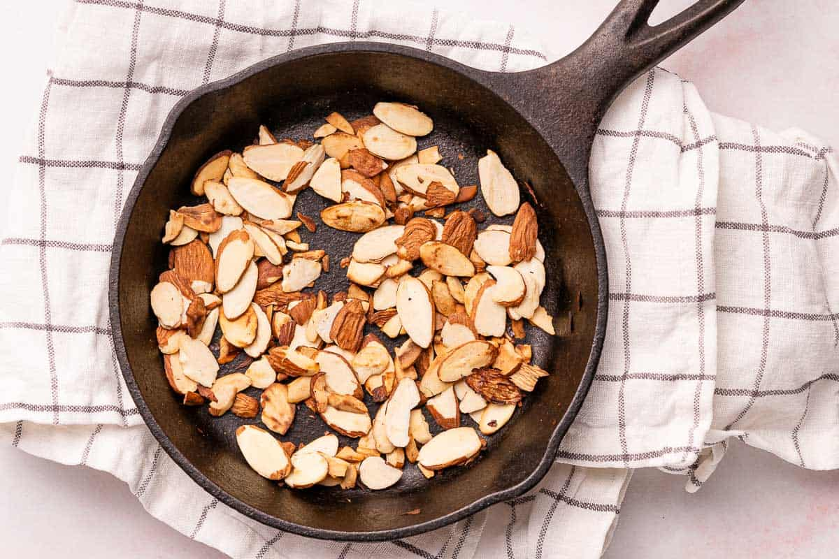 toasted almonds in cast iron pan
