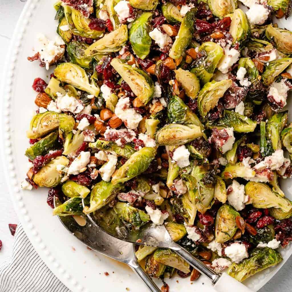 brussels sprouts salad on white platter