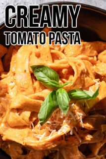 creamy tomato pasta with basil on top and text in the corner