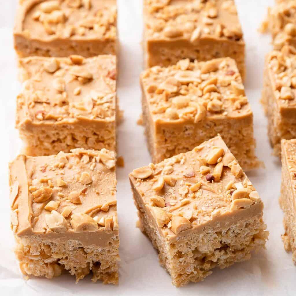 peanut butter rice krispie treats on parchment paper