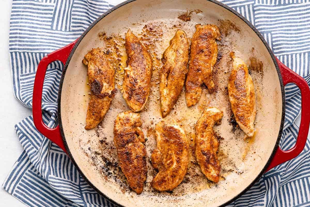 cooked chicken tenders in pan