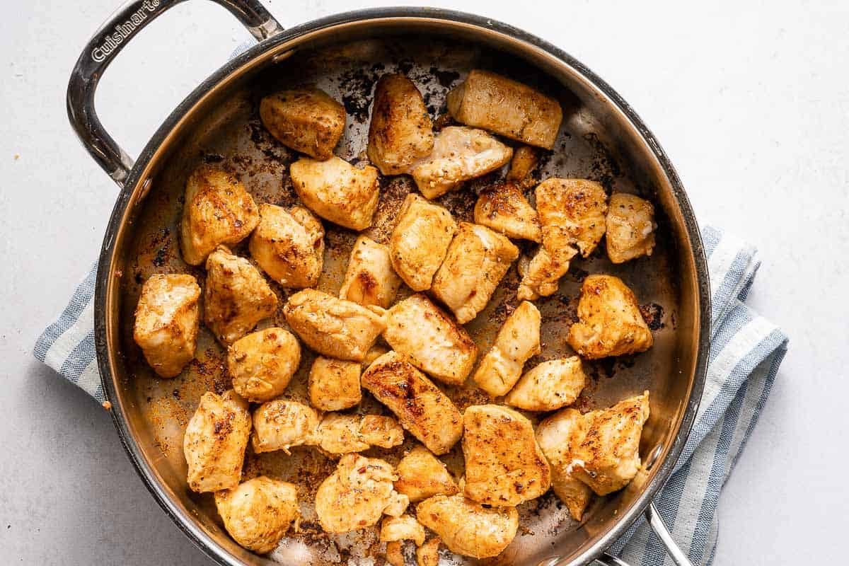 browned chicken chunks in pan