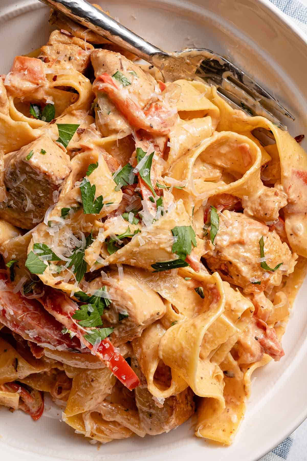 plate of creamy Cajun chicken pasta with fork