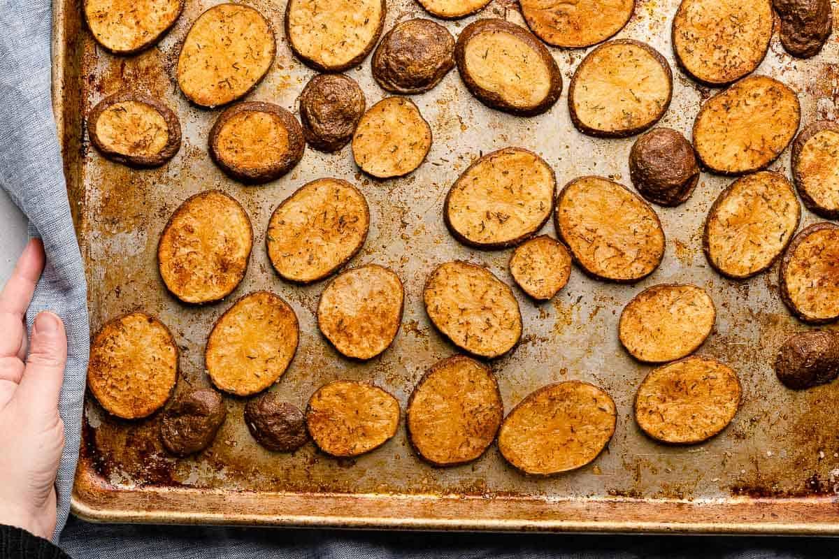 cooked cottage fries on metal baking sheet