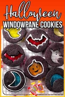 Halloween windowpane cookies on cooling rack with text at the top