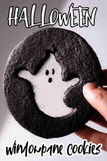 black cookie with ghost design and text label at the top and bottom