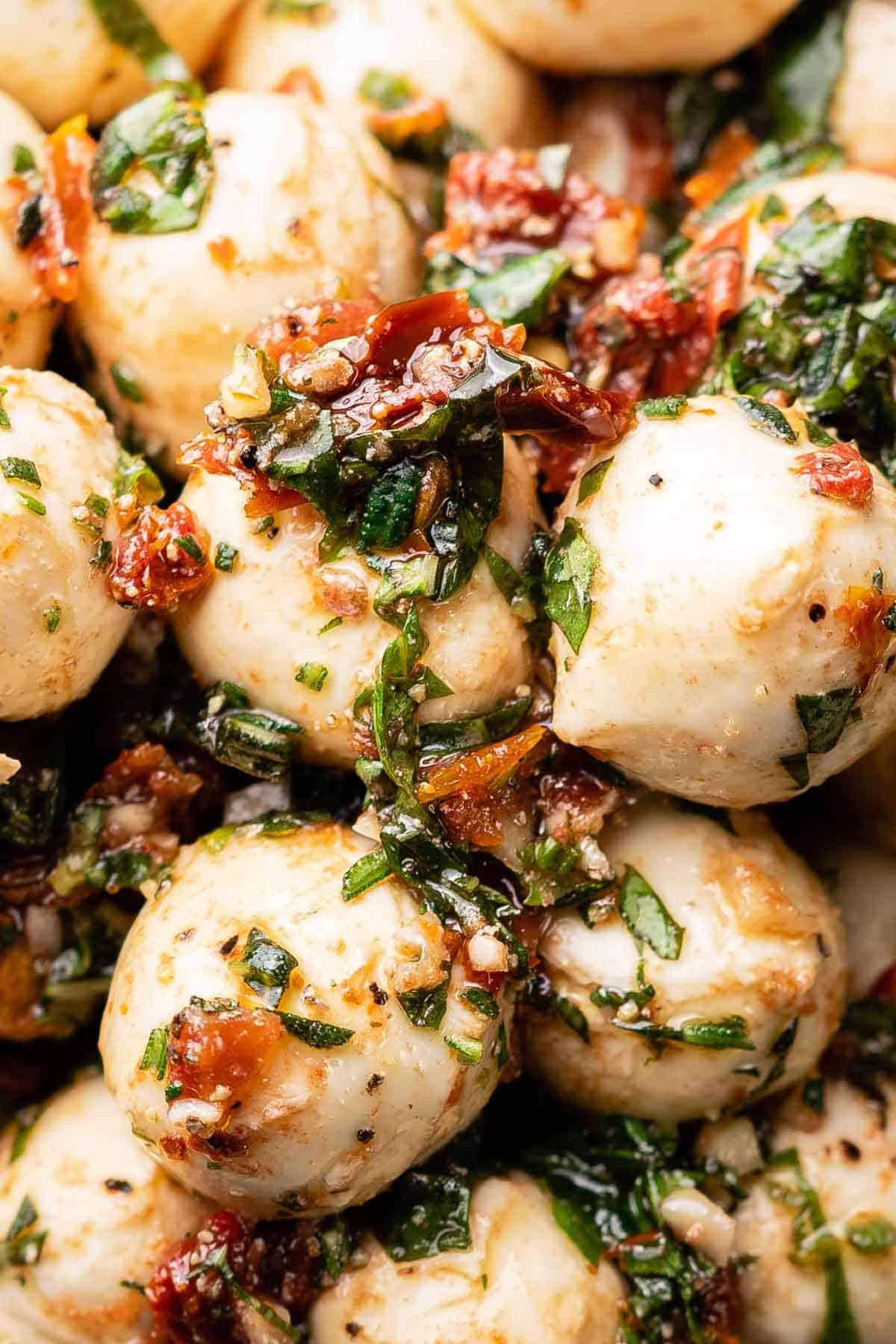 close up view of marinated mozzarella balls